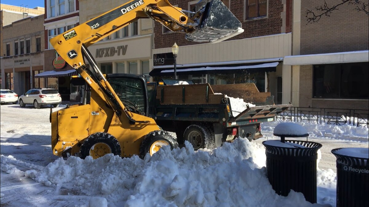 City of Dubuque employees remove snow on Main St. on Wednesday, Feb. 13, 2019. (Allison Wong, KCRG-TV9)