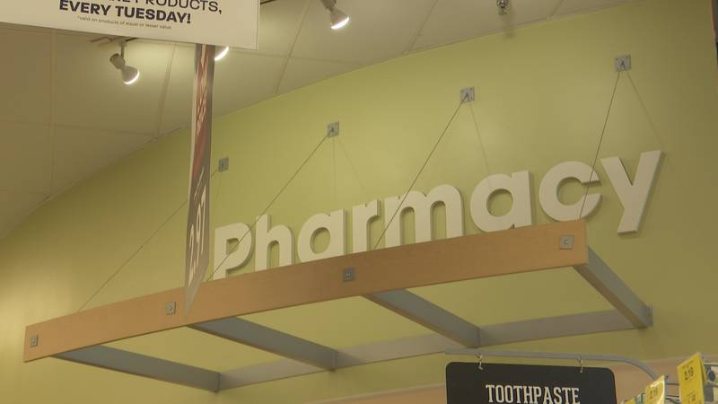 A pharmacy sign is pictured inside Hy-Vee Tuesday, Aug. 24, 2021, in Mankato, Minn. (KEYC...