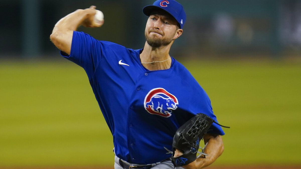 Chicago Cubs pitcher Colin Rea throws against the Detroit Tigers in the ninth inning of a...