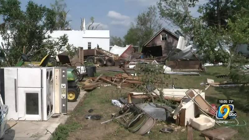 People work to clean up in Waverly after extensive storm damage on Wednesday