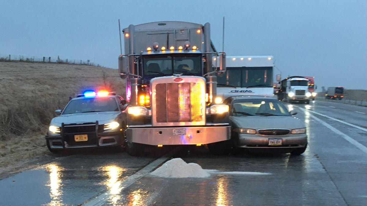 A semi sideswiped an Iowa State Patrol squad car on I-80 in Cedar County on Jan. 15, 2020. A freezing drizzle made for slick conditions across the region. (Iowa State Patrol)