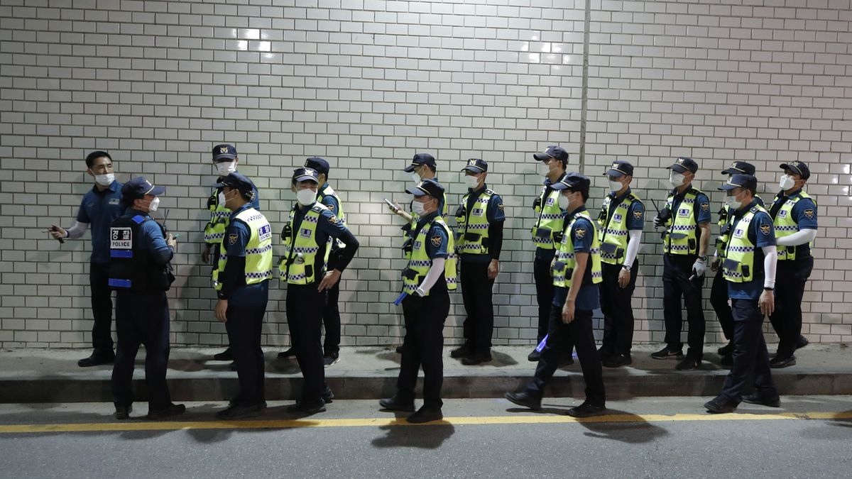 Police officers walk to search for missing Seoul Mayor Park Won-soon in Seoul, South Korea, Thursday, July 9, 2020. Police say Seoul Mayor Park Won-soon has been reported missing and search operations are underway. (AP Photo/Lee Jin-man)