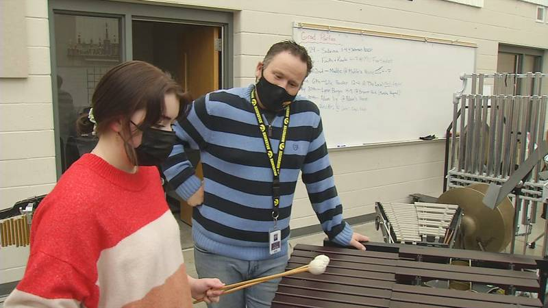 Kayla Wallace practicing percussion with Mount Vernon Band Director Scott Weber