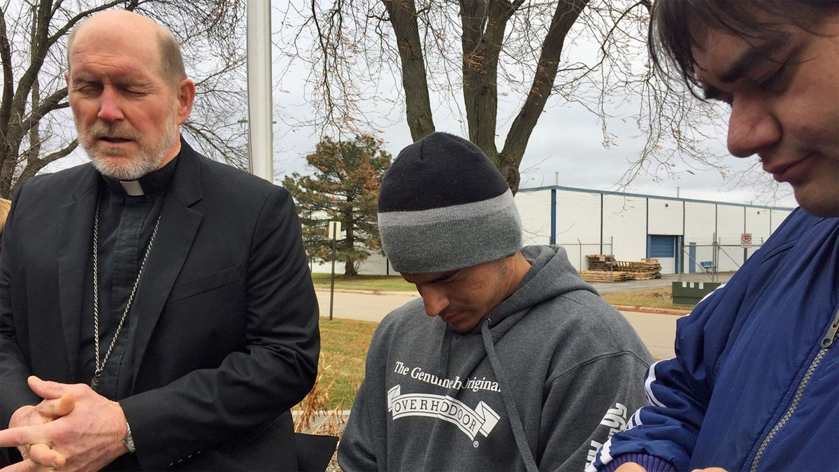 Bishop Thomas Zinkula, left, Alejandro Guzman, center, and Father Guillermo Trevino, right, pray on Wednesday, Nov. 27, 2019 (Jackie Kennon/KCRG)