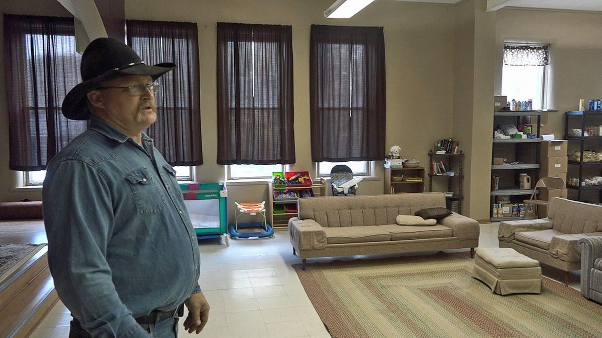 Darren Brown shows a room in the new emergency shelter, opened through the Tribulation and Trust Ministry in Washington on Wednesday, Nov. 6, 2019. (Aaron Scheinblum/KCRG)