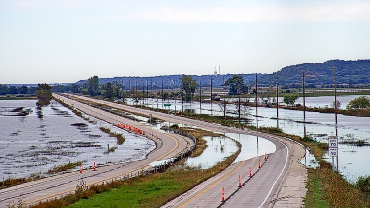 A traffic camera from the Iowa Department of Transportation shows water covering portions of...