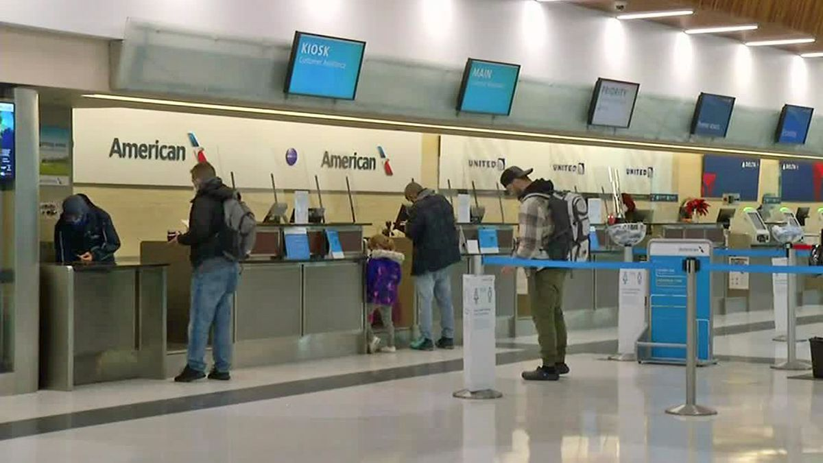 Passengers check in at ticket counters for airlines at the Eastern Iowa Airport.