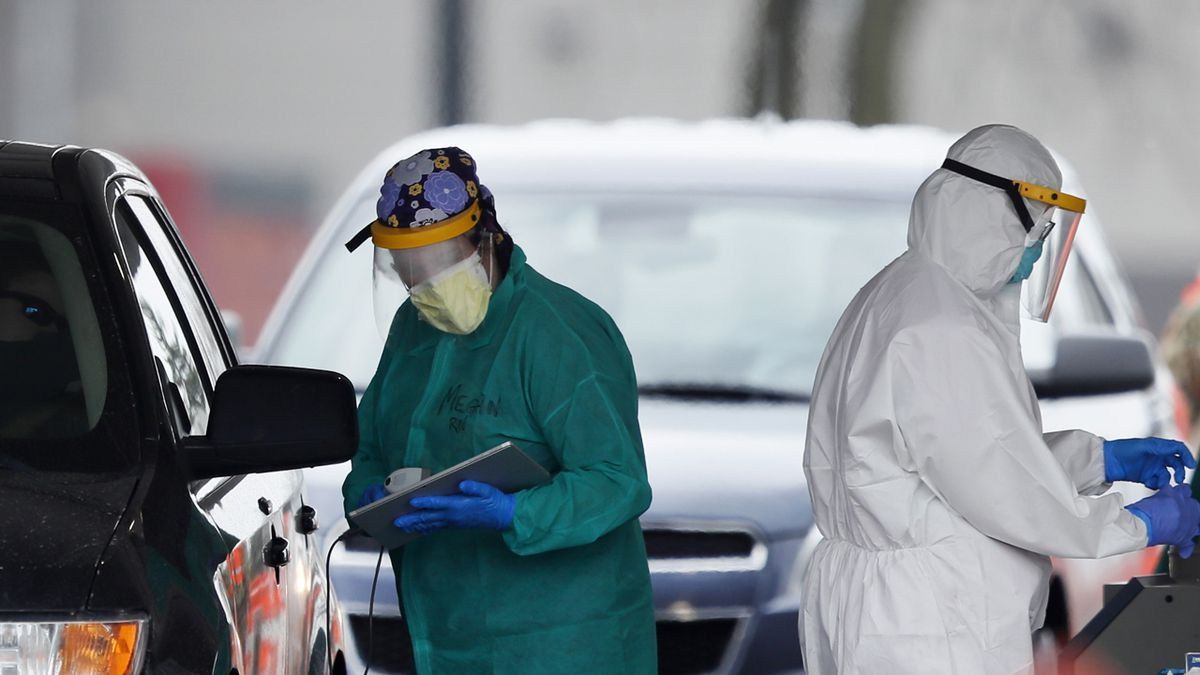 Medical staff administer COVID-19 tests to the public in the Iowa Events Center parking lot, Tuesday, April 28, 2020, in Des Moines, Iowa. (AP Photo/Charlie Neibergall)