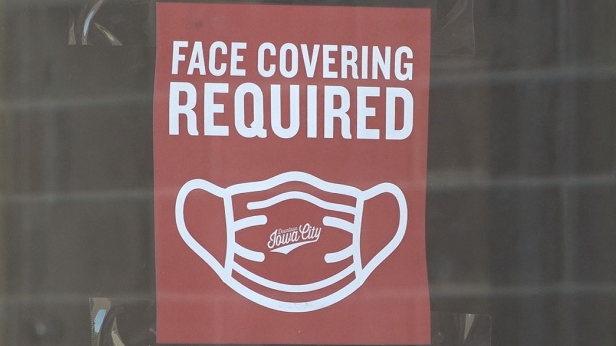 "A sign reads ""Face Covering Required"" outside the Old Capitol Mall in Iowa City on Thursday, July 23, 2020. (Aaron Scheinblum/KCRG)"