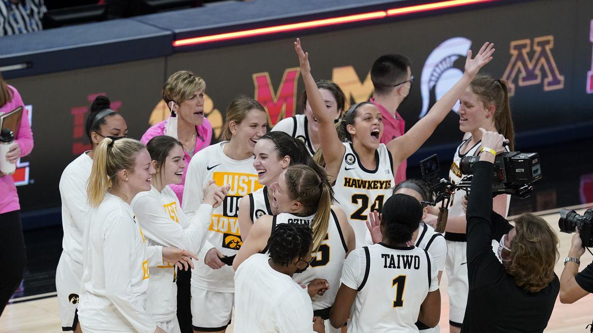 Iowa's Gabbie Marshall (24) celebrates with her teammates after Iowa defeated Michigan State,...