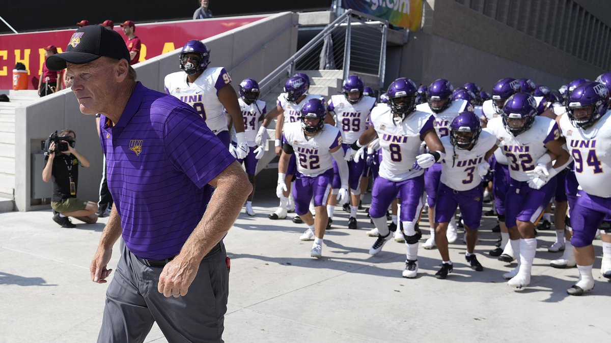 FILE-Northern Iowa head coach Mark Farley leads his team onto the field for an NCAA college...