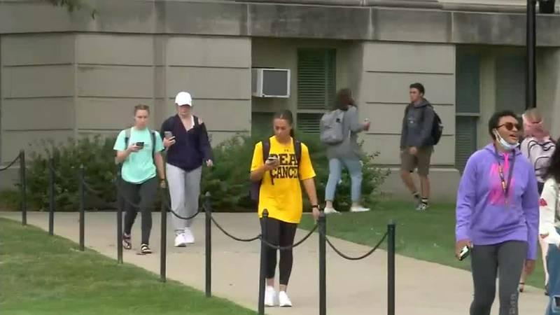Students walk through the University of Iowa Campus.