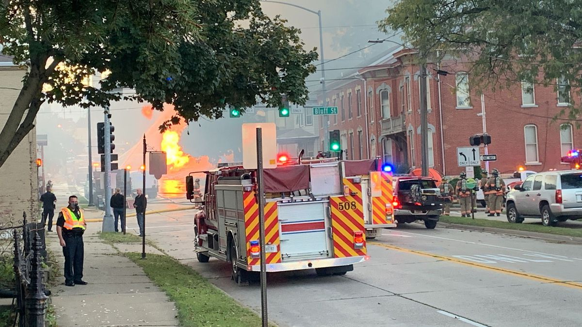 Firefighters and other emergency responders on the scene of a fire caused by an apparent...