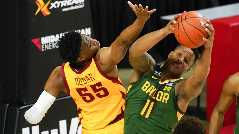 Baylor guard Mark Vital (11) fights for a rebound with Iowa State guard Darlinstone Dubar (55)...