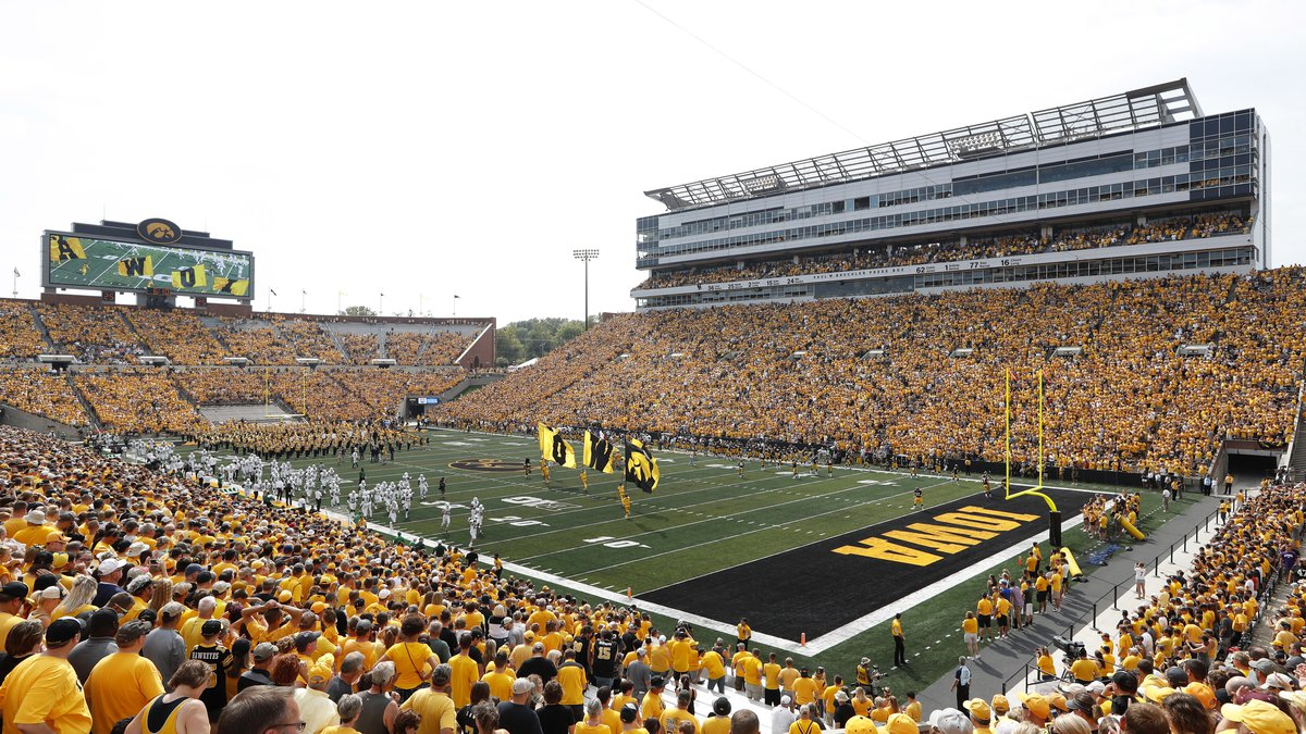 FILE - Fans cheer before an NCAA college football game between Iowa and North Texas at Kinnick...