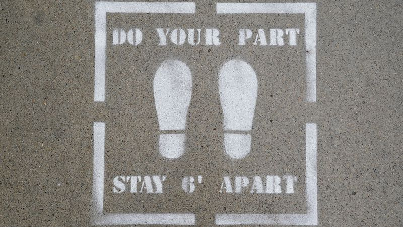 """Do Your Part Stay 6' Apart"" is seen painted on a downtown sidewalk, Thursday, Oct. 22, 2020,..."