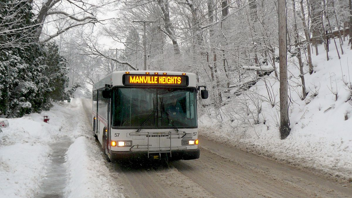 An Iowa City Transit bus drives on a street along the Manville Heights route on Feb. 12, 2019 (Wikimedia Commons/Douglas W. Jones/Public Domain)