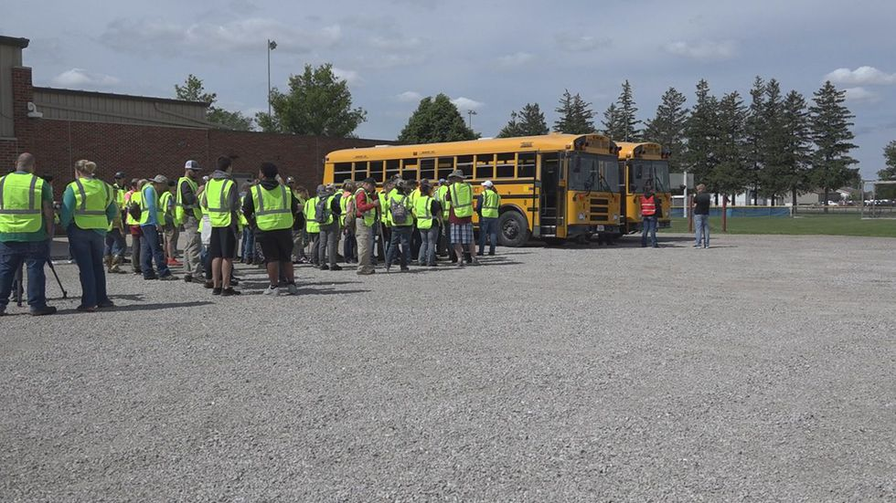 Volunteers gather to help find Xavior Harrelson, 11, on Sunday, May 30 ...