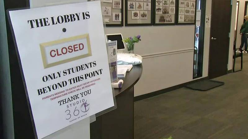 A sign at Studio 360 dance studio in Cedar Rapids indicating that the lobby is closed to...
