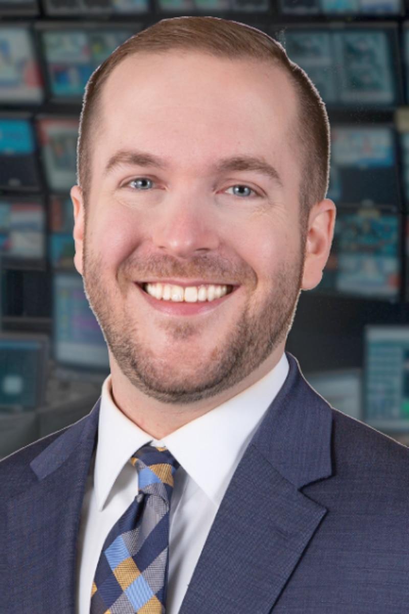 Headshot of Corey Thompson, Meteorologist