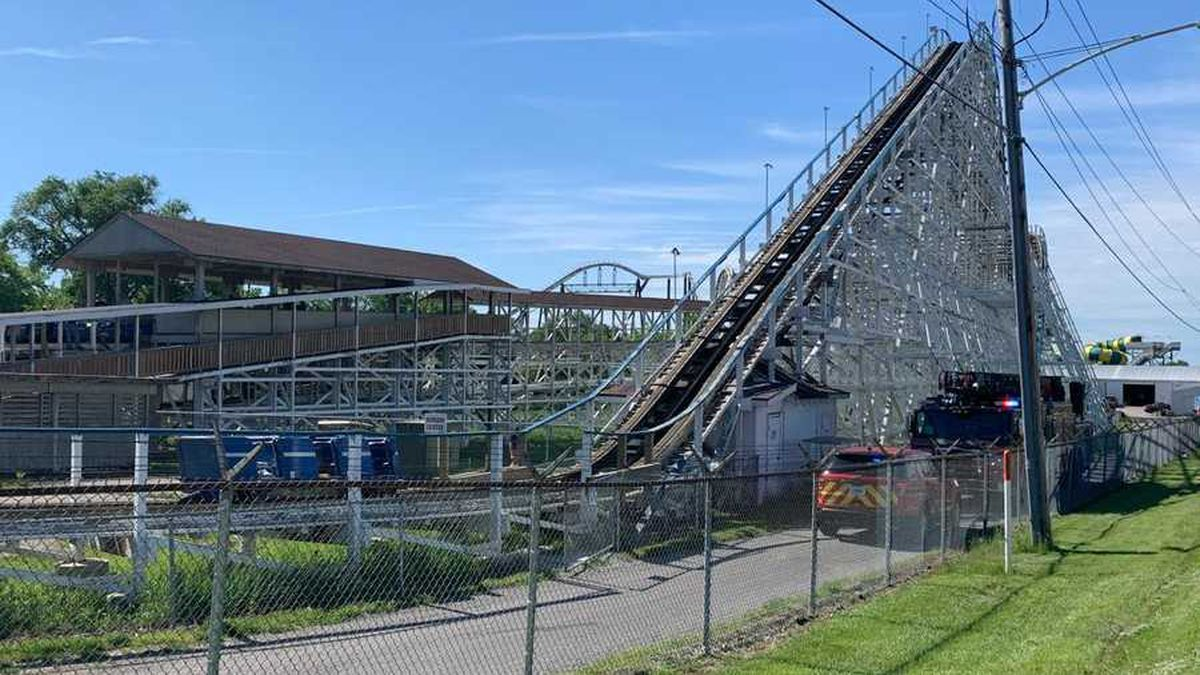 Emergency crews respond to a small fire on the Tornado roller coaster at Adventureland Park in...