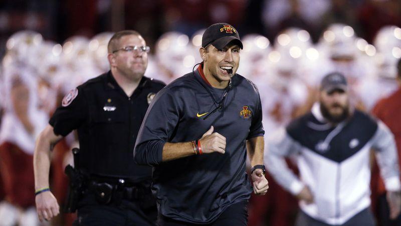 FILE - In this  Nov. 9, 2019, file photo, Iowa State head coach Matt Campbell, center, runs off...
