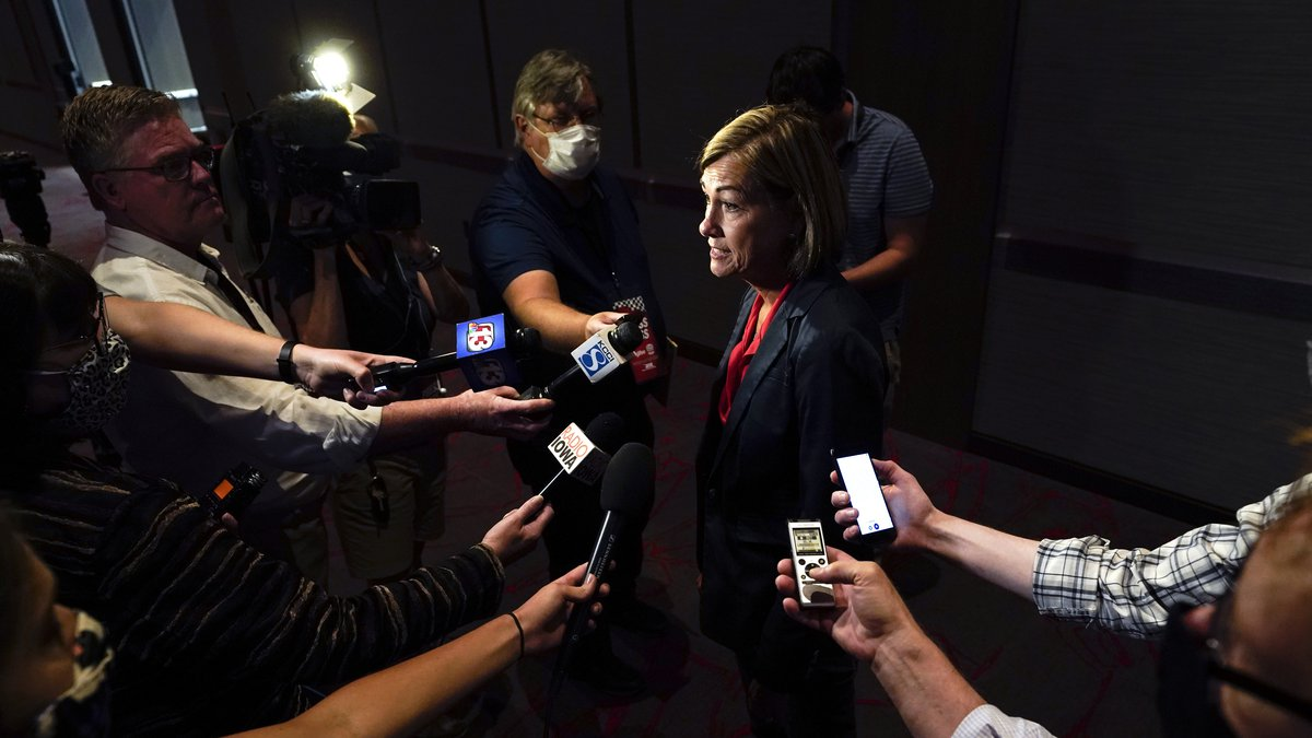 Iowa Gov. Kim Reynolds speaks to reporters following a news conference, Thursday, Aug. 19,...
