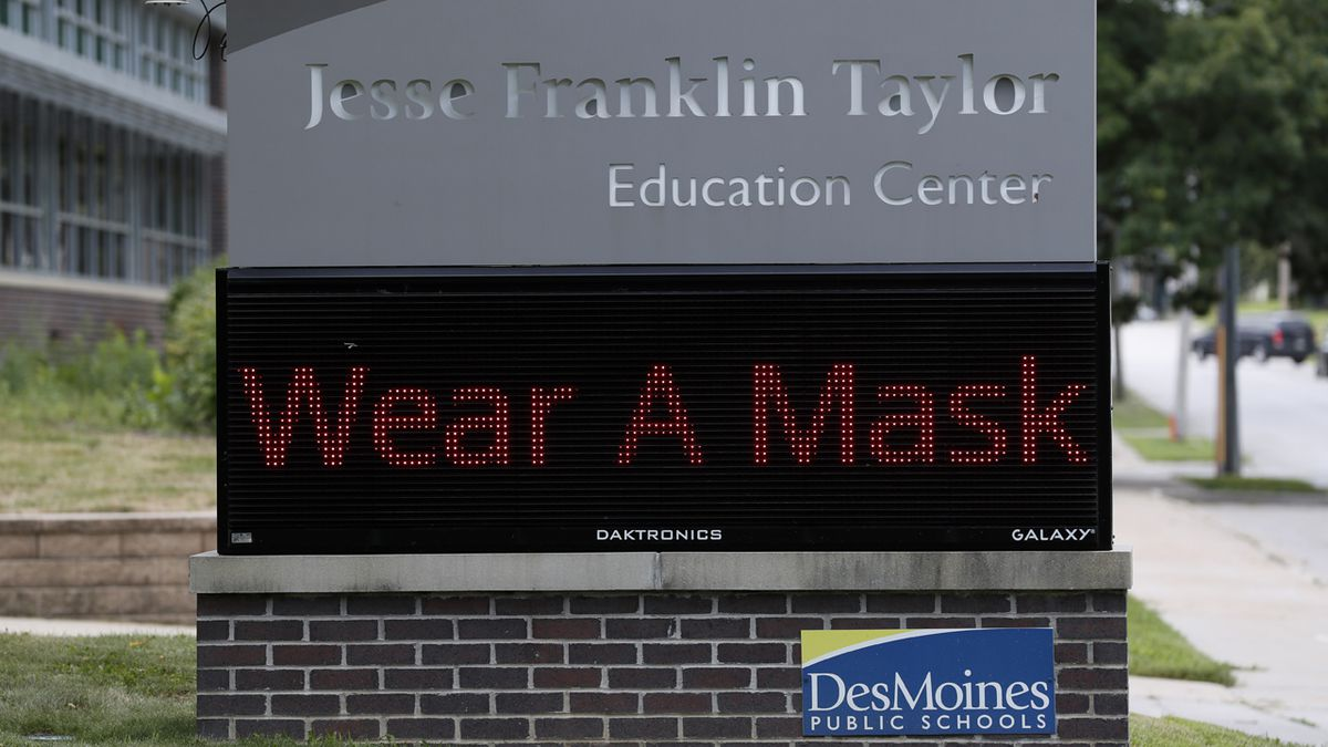 """A sign displaying """"wear a mask"""" sits in front of the Jesse Franklin Taylor Education Center, Wednesday, July 29, 2020, in Des Moines, Iowa."""