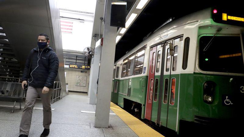 A passenger, left, disembarks a Massachusetts Bay Transportation Authority subway train in an...
