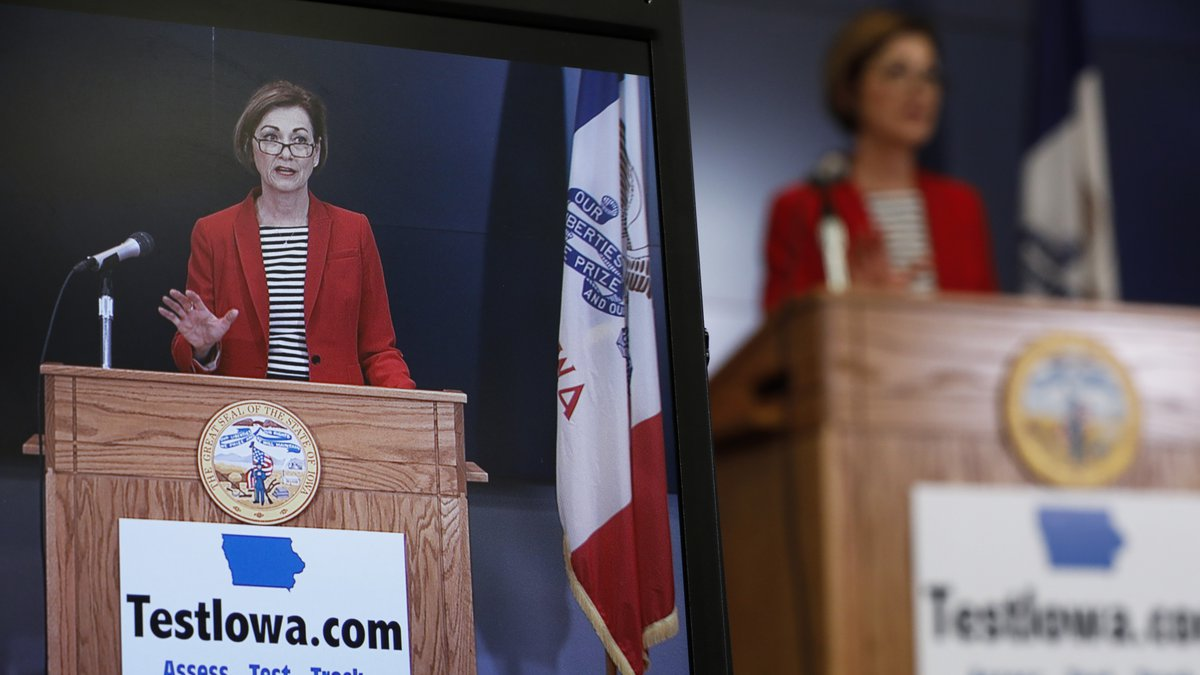 Iowa Gov. Kim Reynolds is seen on a monitor as she updates the state's response to the...