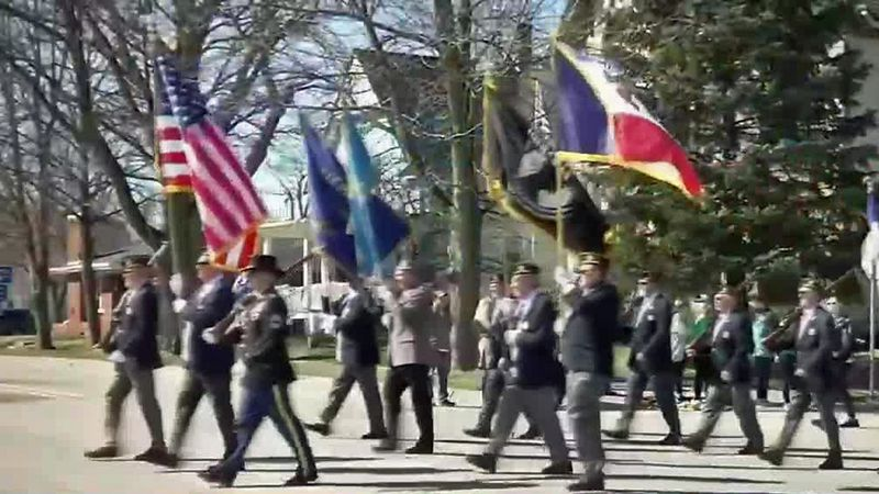 People march in a St. Patrick's Day Parade in Dyersville on Saturday, Mar. 14, 2021.
