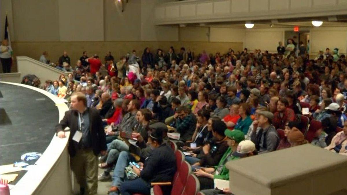 Democratic caucus-goers participate in a precinct caucus in Opstad Auditorium at City High...
