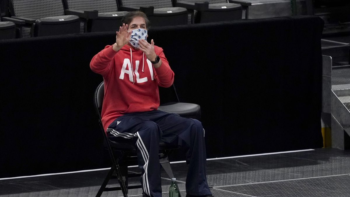 Dallas Mavericks team owner Mark Cuban gestures to officials during an NBA basketball game...