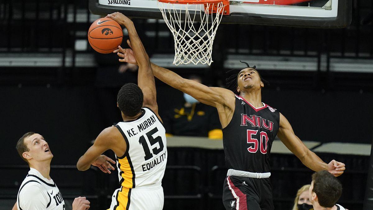 Iowa forward Keegan Murray (15) blocks a shot by Northern Illinois guard Anthony Crump (50)...