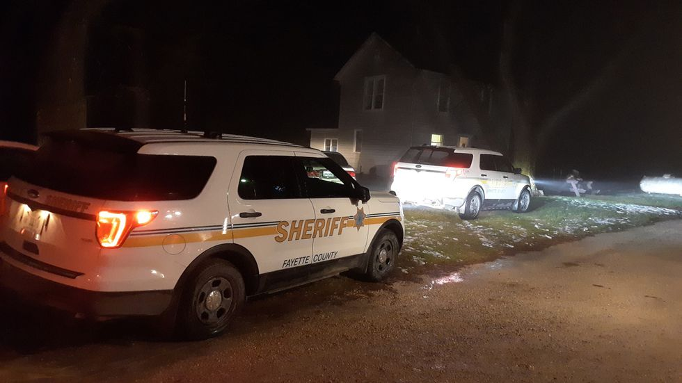 Vehicles with the Fayette County Sheriff's Office at the site of an investigation in Fayette...