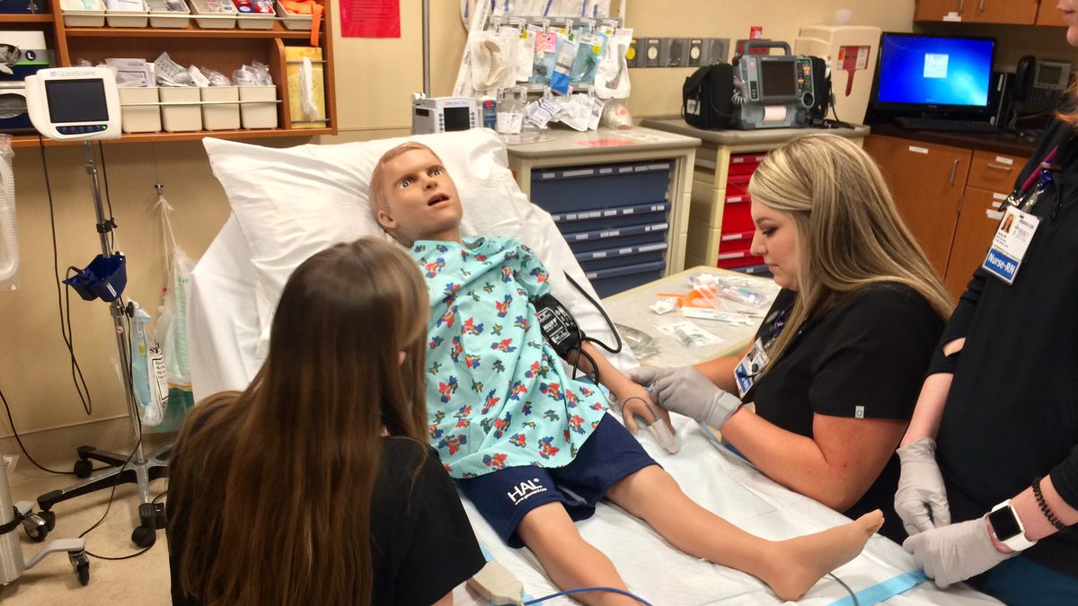 "Resident nursing students at Mercy Medical Center practice on ""Pediatric Hal.""  The life-like simulator is described as the most advance simulator available to mimic a five-year-old patient."