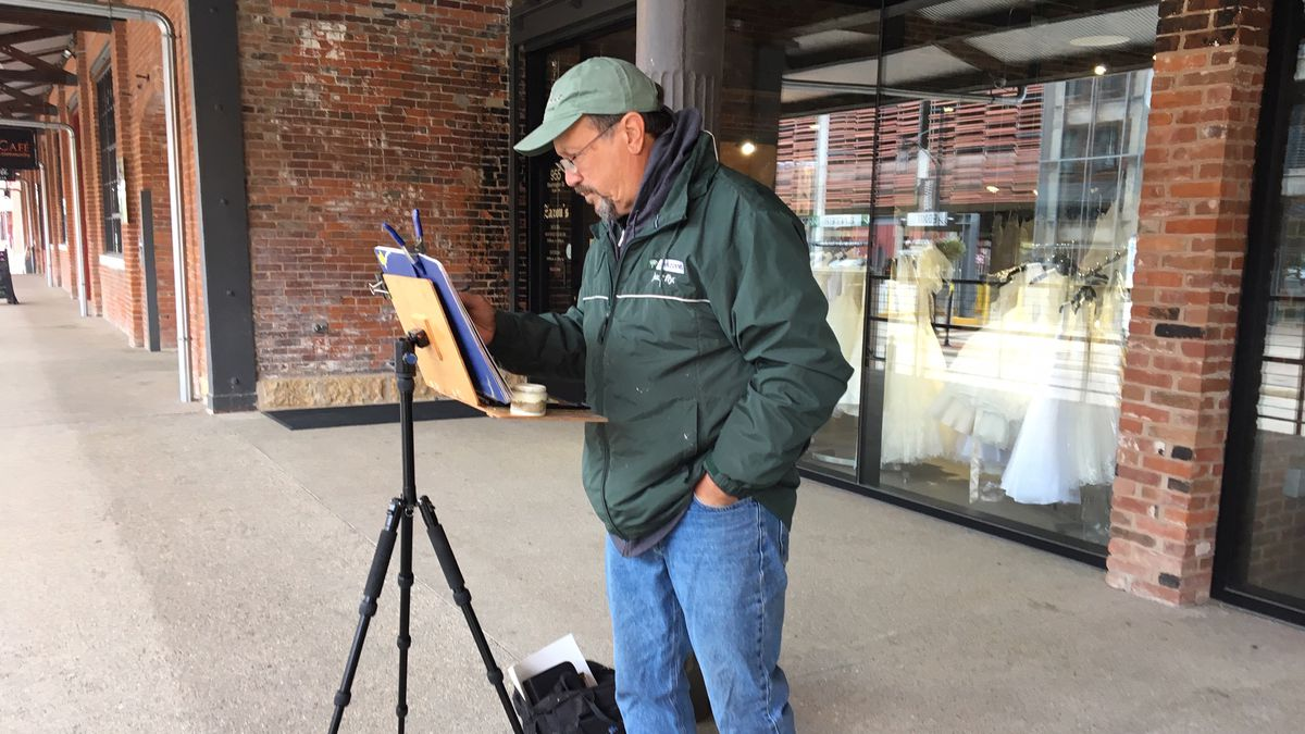 Dennis Babbitt paints the Millwork District in Dubuque for the Bluff Strokes Paint Out on Friday, October 11, 2019. (Allison Wong, KCRG)