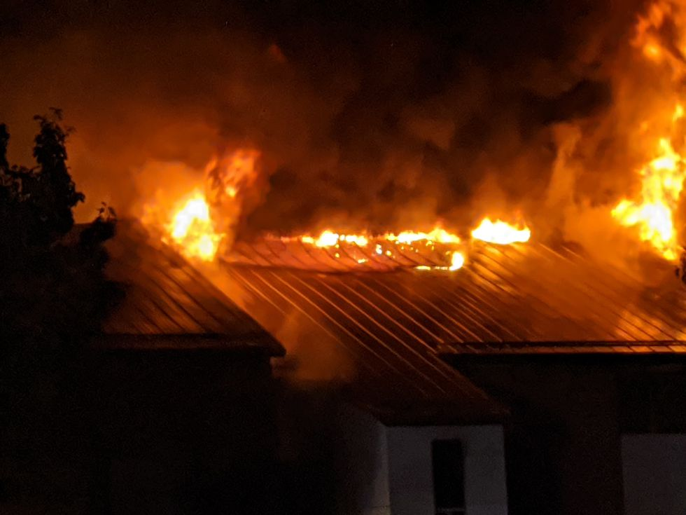 Flames coming from a reported apartment fire in Norway, Iowa.