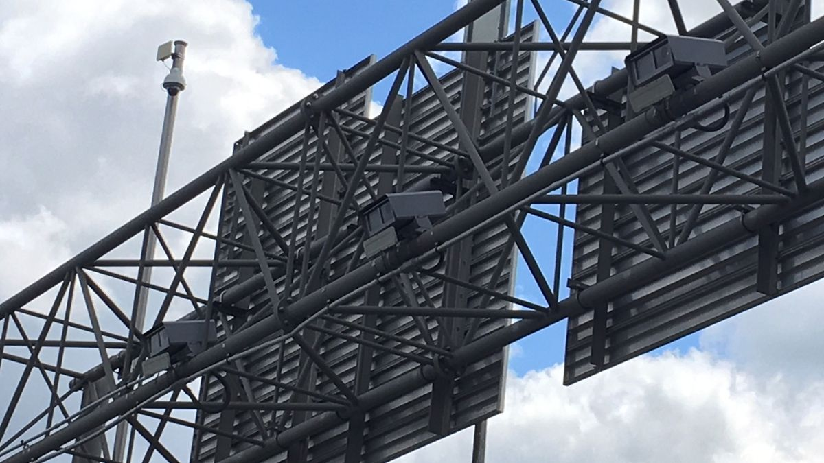 Automatic traffic cameras on an overhead sign structure along Interstate 380 in Cedar Rapids on May 13, 2019 (Mary Green/KCRG)