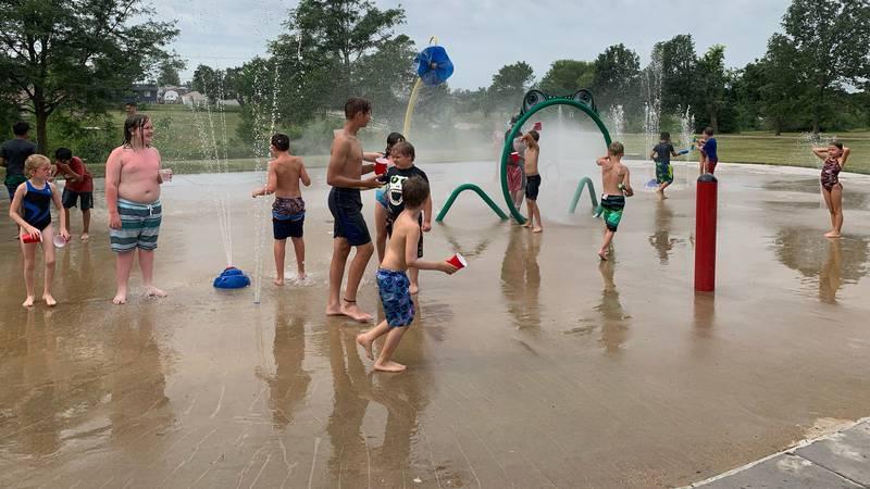 Kids enjoy the Noelridge Park splash pad on July 28, 2021.