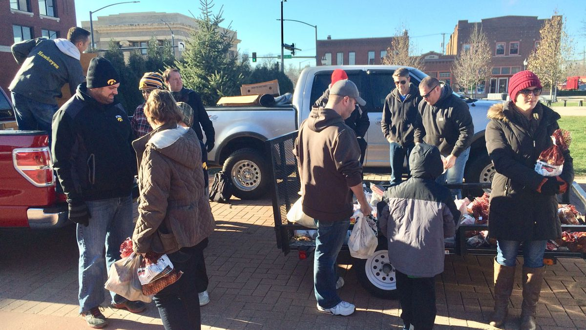 Recipients of holiday food baskets line up outside the NewBo City Market in Cedar Rapids on Wednesday, Nov. 22, 2017.  The giveaway started as a prank but turned into a real event. (Dave Franzman/KCRG-TV9)