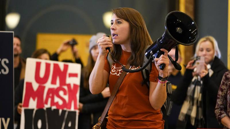 Brei Johnson speaks as protestors gather in the Iowa Capitol rotunda to voice their opposition...