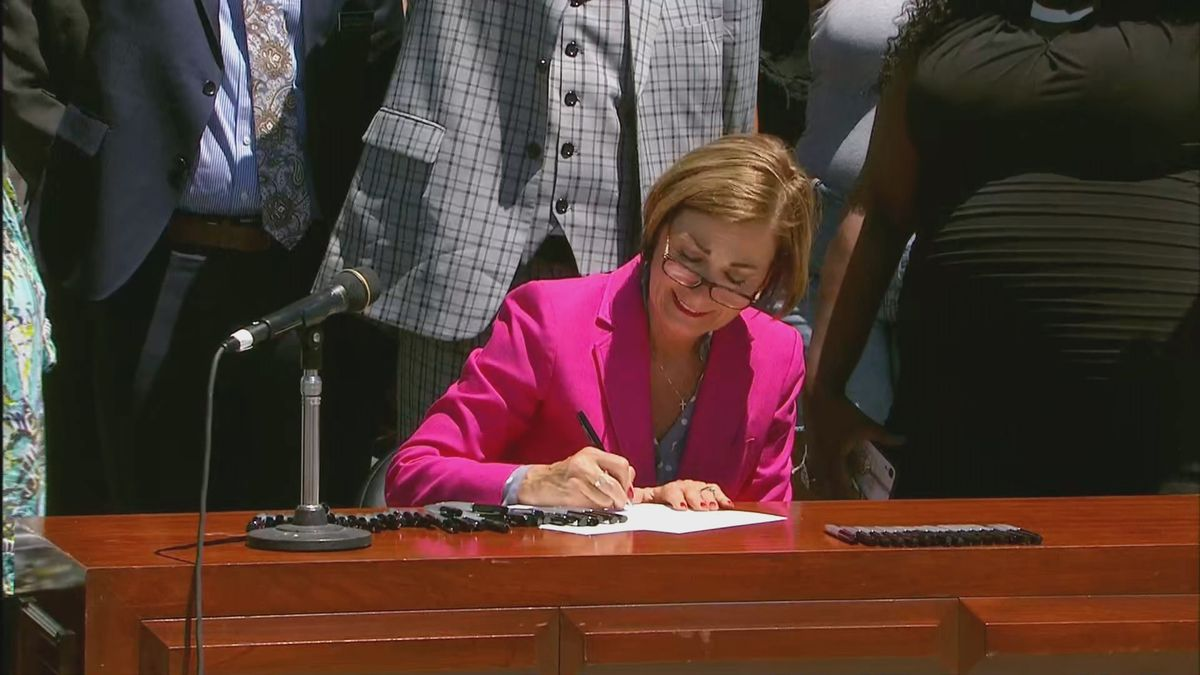 Iowa Governor Kim Reynolds signs police reform bill on 6-12-2020