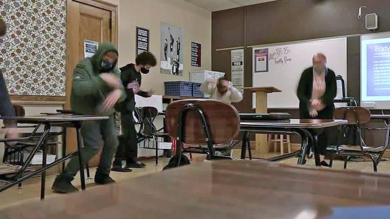 Students in an eighth-grade class at Wilson Middle School in Cedar Rapids take a dance break...