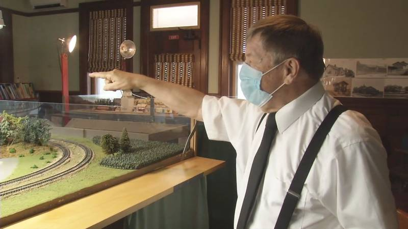 Benton County Historical Society Member, Phil Borleske next to a model train replicating the...