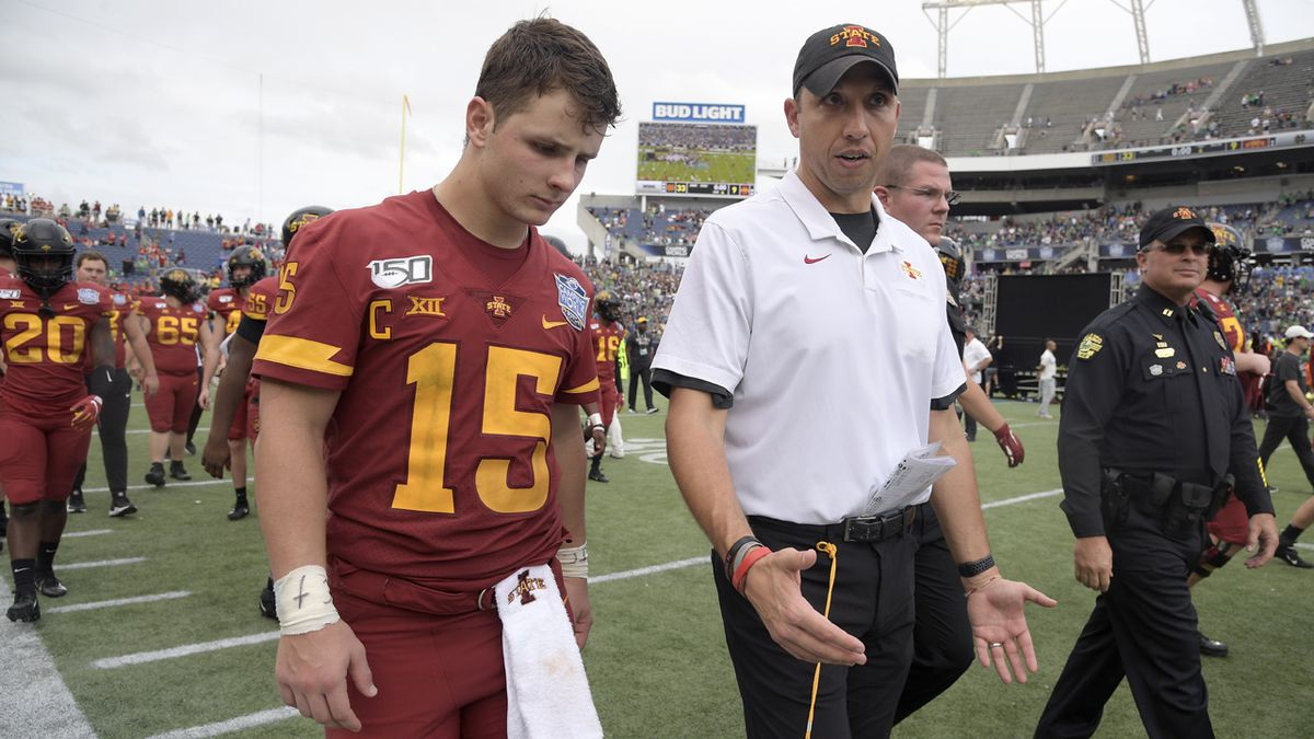 FILE - Iowa State head coach Matt Campbell, center, walks off the field with quarterback Brock Purdy after the Camping World Bowl NCAA college football game against Notre Dame Saturday, Dec. 28, 2019, in Orlando, Fla. Iowa State enters this season off its second-best three-year stretch in program history and with its sights set on doing something it's never done — make the Big 12 championship game.