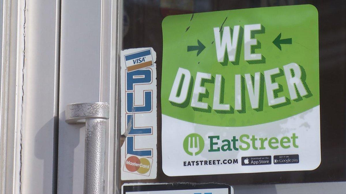 An EatStreet sticker is on Mario's front door in Dubuque. (Charlie Grant, KCRG-TV9)