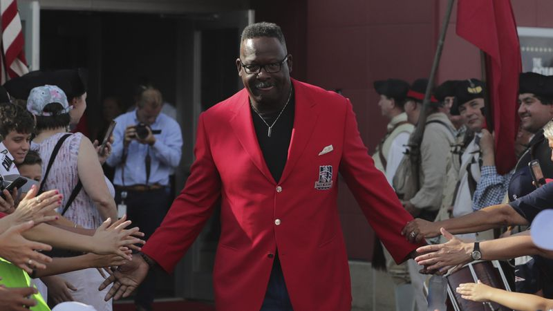 New England Patriots great Andre Tippett is greeted by fans during a ceremony at Gillette...
