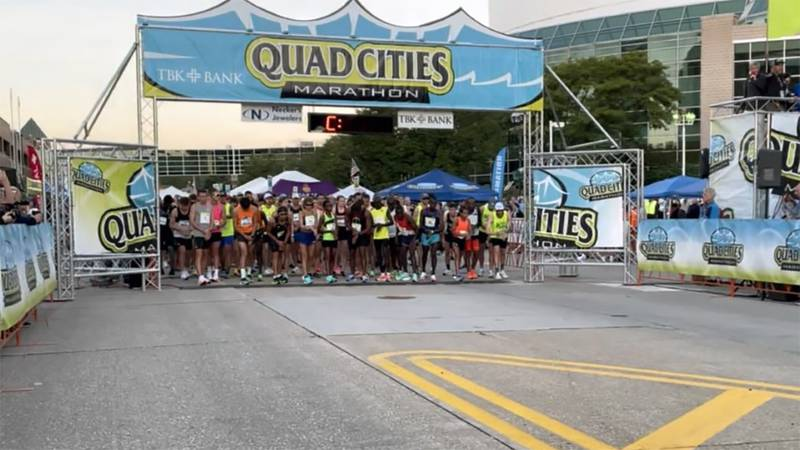 Runners line up at the starting line for the Quad Cities Marathon.