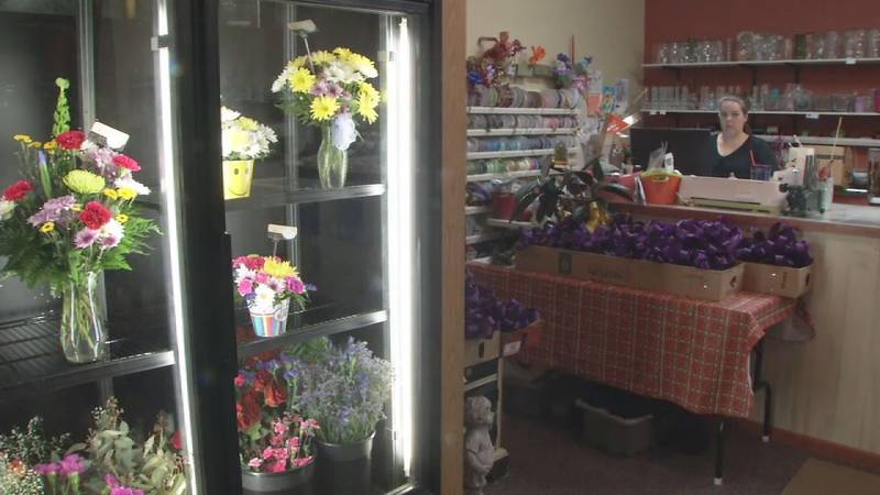 Sarah Taylor, owner of Sarah's Flowers & Gifts in downtown Manchester, says her business...